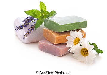 handmade soap bars with lavender flowers on white background