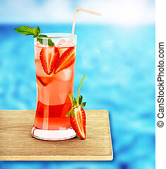Strawberry juice on the poolside - Strawberry juice on the...
