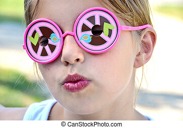Peace Sign Sunglasses - Little girl wearing funky sunglasses...