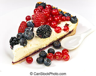 Piece of a pie with fresh berries on a plate