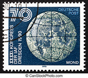 Postage stamp GDR 1990 Moon - GDR - CIRCA 1990: a stamp...
