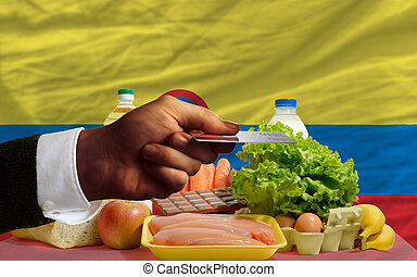 buying groceries with credit card in colombia - man...
