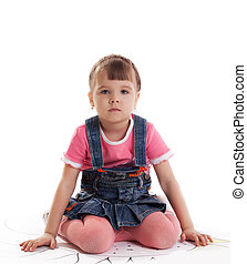 Little girl sitting on floor