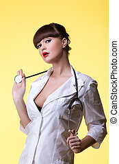 Sexy nurse with stethoscope - Studio portrait of sexy nurse...