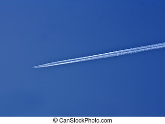 trail of white smoke from the airplane on blue sky