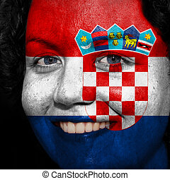 Woman with flag painted on her face to show Croatia support