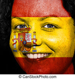 Woman with flag painted on her face to show Spain support