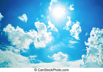 white clouds in sunny blue sky.