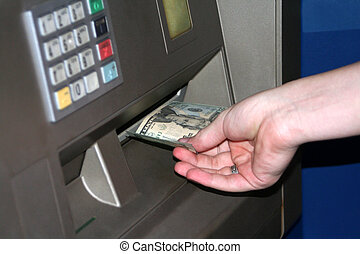 Teen ATM Transaction - Closeup view of the hand of a teenage...