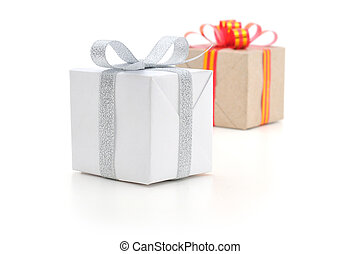 Gift Boxes - Gift boxes with different ribbons in white...