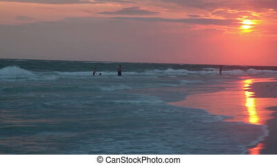 Sunset on the beach - Lido beach, Sarasota, Florida. people...
