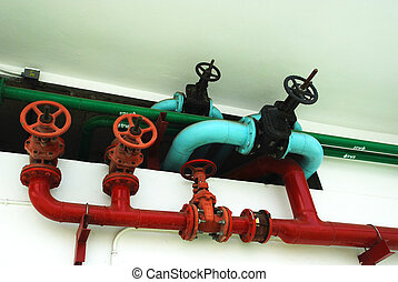 The pipes and valves water on the wall