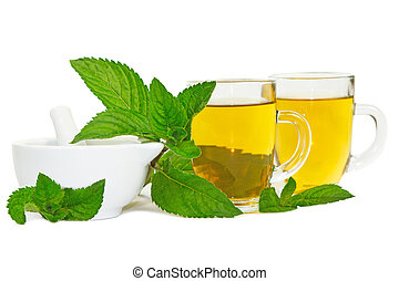 Lemon balm or mint tisane or tea - Pestle and mortar with...