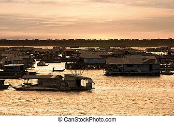 Tonle Sap Lake - Sunset shot of Floating Village at Tonle...