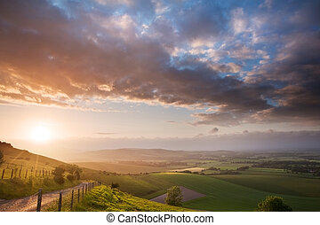Beautiful English countryside landscape over rolling hills -...