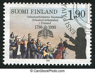 Playing Orchestra - FINLAND - CIRCA 1990: stamp printed by...