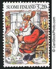 Santa Reading Letters - FINLAND - CIRCA 1996: stamp printed...