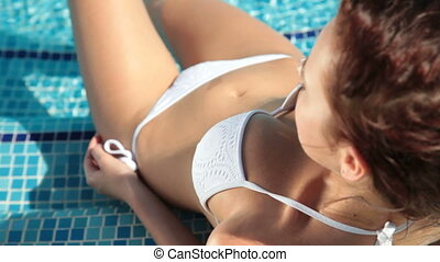 Young Bikini Woman Sunbathing