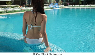 Poolside Bikini Female - Beautiful woman relaxing in a pool...