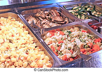 steel trays filled with great food in a Italian restaurant -...