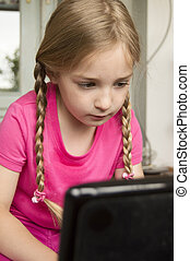 girl focused at computer