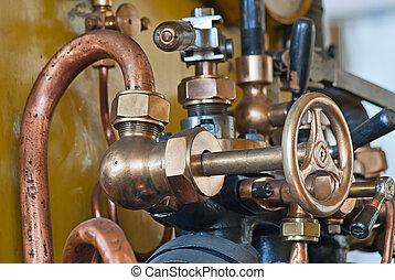 old train steam engine - brass valve of old train steam...