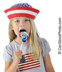 Licking Patriot - Closeup of an adorable preschooler wearing...