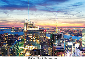 New York City skyline aerial view at dusk with skyscrapers...