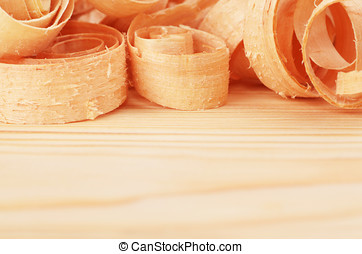 Wooden chips on the natural pine plank