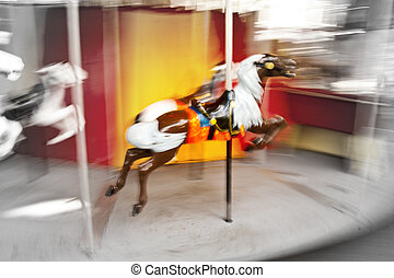 Spinning Carousel - an action blurred shot of a horse on a...
