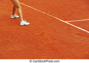 Detail of the legs of a tennis woman