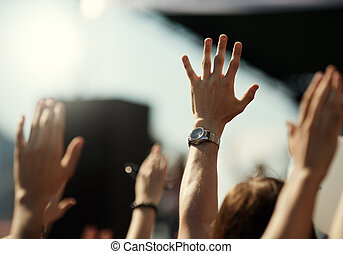 rock concert - hands of crowd on the music show , selective...