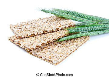 crispbread with ears and wheat grain, isolated on a white background