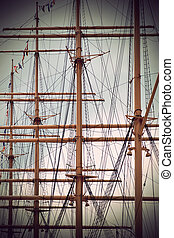 masts of old sailing ship in sepia