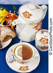 Tea with lemon croissant