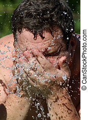 Man washing his face Water drop and spash