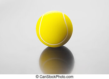Tennis ball  on grey background