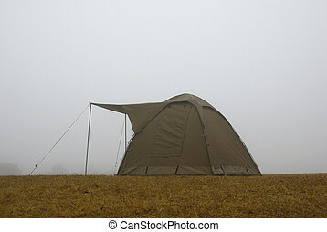 Camping tent in the fog