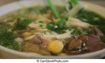 Vietnamese Pho, with someone eating - Traditional Vietnam...