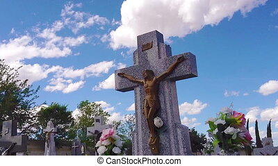 Stone cross with Jesus figure in a