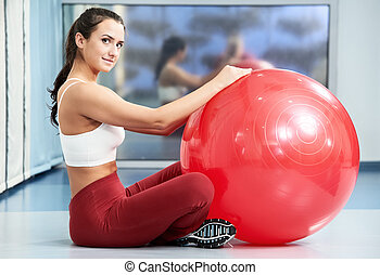 Happy healthy woman with fitness ball