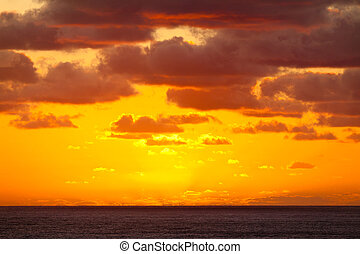 Spectacular dramatic orange sunset over the ocean -...