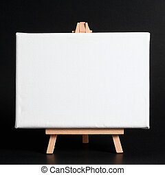 Wooden easel with blank canvas on a dark background.