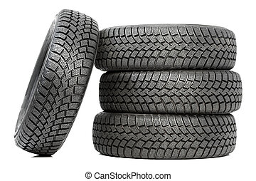 Stack of four car wheel winter tires isolated - Stack of...