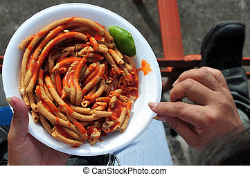 Mexican food - Mexican person eating Mexican food during a...