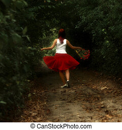Girl in the woods - Girl in red dress with the flowers in...