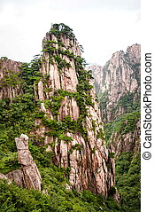 Huangshan mountain peak in a valley in China