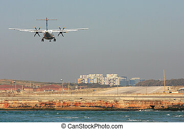 Passenger airplane landing on runway - Passenger airplane...