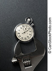 Wrench and stopwatch