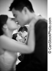 Dancing groom and bride - Kissing couple groom and bride...